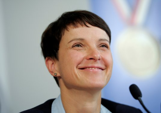 Frauke Petry, chairwoman of the anti-immigration party Alternative for Germany smiles at a news conference in Berlin