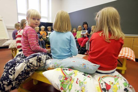 Children listen to their teacher 17 Augu
